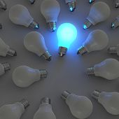 3D Growing Light Bulb Standing Out From The Unlit Incandescent Bulbs As Leadership