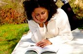 image of girl reading book  - relaxing woman reading - JPG