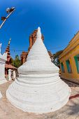 Small white stupa in The Shwezigon Pagoda complex