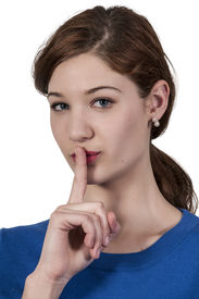 image of shhh  - A woman saying be quiet by saying shhh - JPG