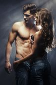 picture of sexing  - Beautiful young smiling couple in love embracing indoor - JPG