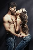 pic of sexing  - Beautiful young smiling couple in love embracing indoor - JPG
