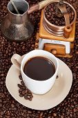 foto of pot roast  - above view cup of coffee and roasted coffee beans with retro manual mill coffee pot - JPG