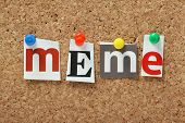 stock photo of plagiarism  - The word Meme in magazine letters pinned to a cork notice board - JPG