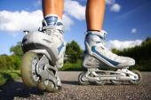 picture of inline skating  - Inline skates in action closeup - JPG