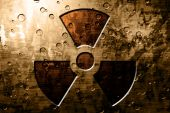 pic of nuke  - Grunge metal plate with a nuclear sign on it - JPG