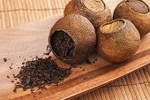 Chinese Tea Pu-erh Packed In Dried Mandarins On Wooden Table