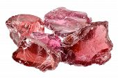 stock photo of uncut  - A pile of purple red rhodolite garnet gemstone crystals uncut rough - JPG
