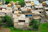 stock photo of himachal  - Small Indian village hidden in Himalaya mountains - JPG
