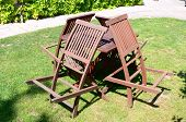 pic of lawn chair  - four wooden folding chair attached to the table on the lawn - JPG