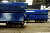 stock photo of railcar  - Industry detail with a freight wagon on the factory production line - JPG