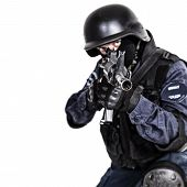 stock photo of terrorist  - Special weapons and tactics SWAT team officer with his gun - JPG