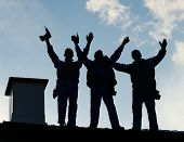 picture of team building  - Building roof construction site teamwork silhouette - JPG