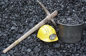 stock photo of mines  - Mining tools on a background of coal - JPG