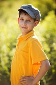 picture of debonair  - Happy boy in cap standing and smiling - JPG