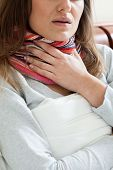 stock photo of pharyngitis  - Image of feeling sick woman in the scarf - JPG