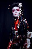 stock photo of geisha  - young pretty geisha in kimono with sakura and decoration close up - JPG