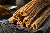 stock photo of churros  - Homemade Deep Fried Churros with Cinnamon and Sugar - JPG