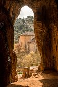 stock photo of templar  - view of a Templar chapel from inside a cave