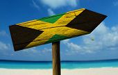 stock photo of bandeiras  - Jamaica wooden sign with a beach on background  - JPG