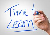 image of time study  - Time to Learn hand writing with a blue mark on a transparent board - JPG