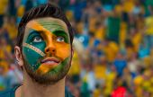 stock photo of carnival brazil  - Brazilian painted the flag of Brazil on his face - JPG