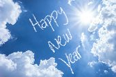 pic of reveillon  - Happy New Year written on a beautiful sky - JPG