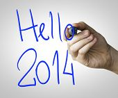 picture of reveillon  - Hello 2014 hand writing with a blue mark on a transparent board - JPG