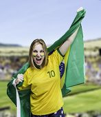 foto of brasilia  - Woman holds a flag of brazil on the Stadium - JPG