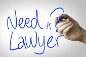 stock photo of lawyer  - Need a Lawyer hand writing on blue marker on transparent wipe board - JPG