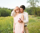 foto of love making  - The man closed his eyes a woman making a surprise ring engagement wedding  - JPG