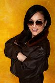 foto of bomber jacket  - Pretty Latina Woman Seated on Colorful Chair - JPG