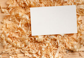 image of woodcarving  - business card on wooden table for tools - JPG