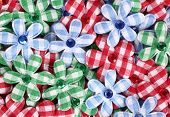 pic of applique  - Flower shaped applique pile made of plaid textile - JPG