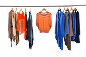 stock photo of racks  - Female Variety of colorful clothes hanging on the rack - JPG