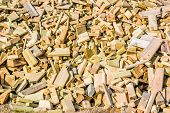 picture of raw materials  - Leftover wooden pieces piled up to form a fine background - JPG