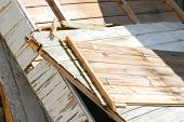 pic of wooden shack  - broken wood panels from a demolished shack - JPG