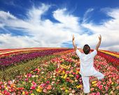 picture of buttercup  - An woman dressed in white doing yoga pose  - JPG
