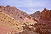picture of dirt road  - Woman photographer on a dirt road at the foot of King Solomon - JPG