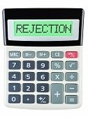 foto of rejection  - Calculator with REJECTION on display on white background - JPG