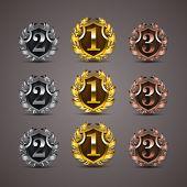stock photo of laurel  - Set of luxury golden vector shields with laurel wreaths - JPG