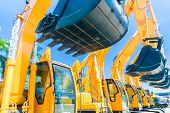 pic of excavator  - Asian Vehicle fleet with construction machinery of building or mining company - JPG
