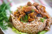 image of stew  - buckwheat cooked with stewed chicken gizzards in gravy - JPG