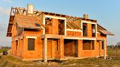 foto of brick block  - Rough brick building house under construction - JPG