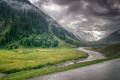 stock photo of jammu kashmir  - storm clouds over mountains and Indus river of ladakh green valley sccenary Jammu and Kashmir India - JPG