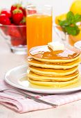 stock photo of maple syrup  - Pancakes with maple syrup and butter on the table  - JPG