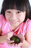 pic of loam  - Young girl with two hands holding sapling soil - JPG