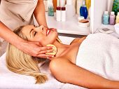 pic of beauty parlour  - Young woman getting facial  massage in beauty spa - JPG