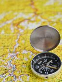 pic of compasses  - The magnetic compass is located on a topographic map - JPG
