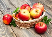 picture of wooden basket  - Apples in the basket on a wooden background - JPG